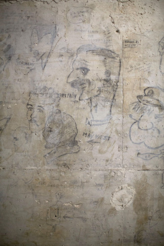 WWII-era drawings on the wall serve as a reminder of the cave's long, varied history.