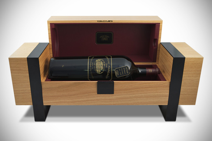 The gold-engraved bottle rests in a case designed to resemble the barrels resting in Margaux cellars.