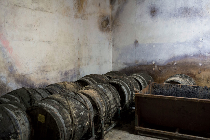 Ancient casks rest quietly in a corner.