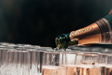 Opening Champagne - Champagne poured into glasses